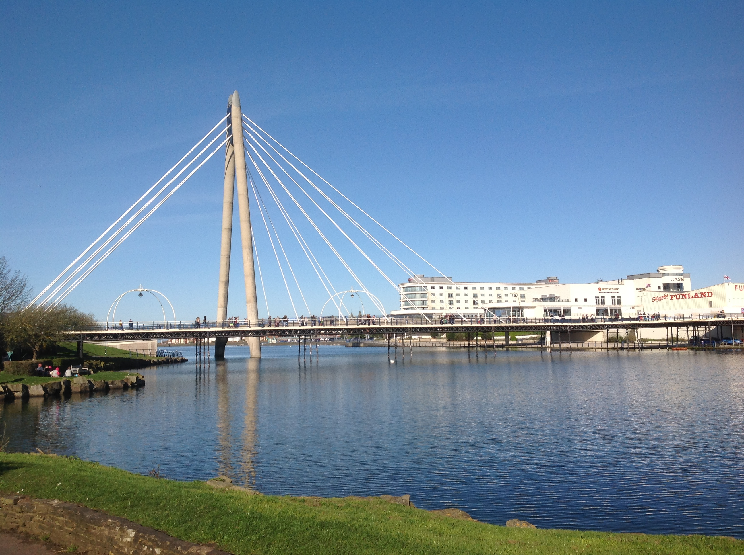 The Marine Lake in Southport, with the Marine Way Bridge, Southport Pier, Bliss Hotel and Kings Gardens.