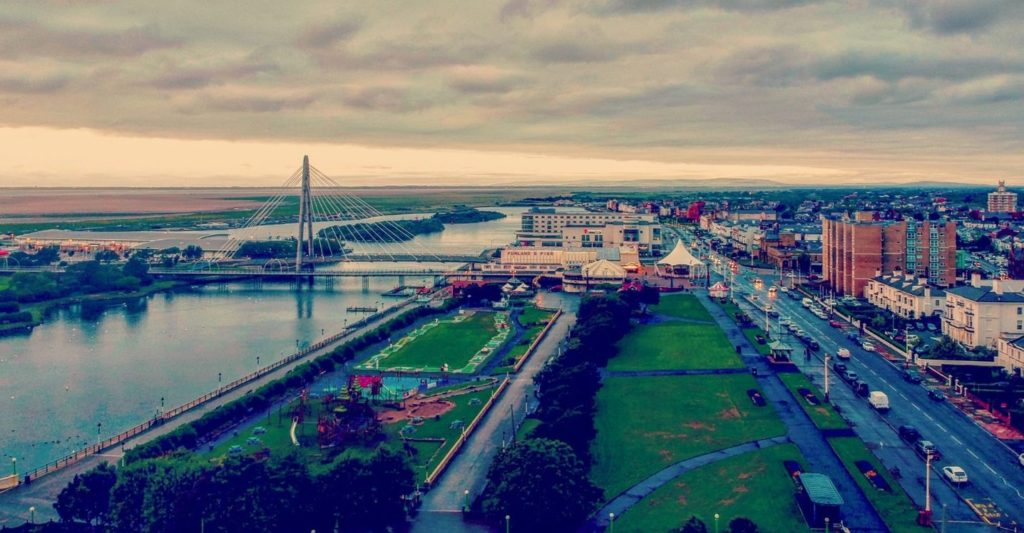 An aerial view of Southport, including the Marine Lake, King's Gardens, the Marine Way Bridge and Bliss Hotel.