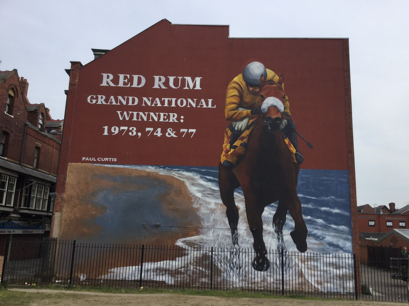 Liverpool mural artist Paul Curtis and the huge Red Rum artwork in Southport