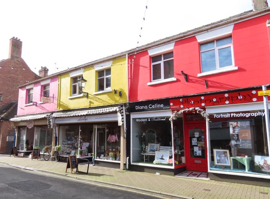 The colourful Wesley Street is among the many great shopping street in Southport. Photo by Andrew Brown Media