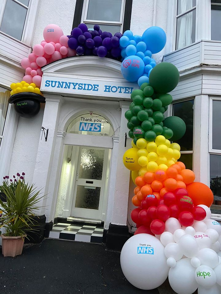 A rainbow balloon arch celebrating NHS workers has been created around the entrance of the Sunnyside Hotel in Southport. Photo by Anthony Duffey