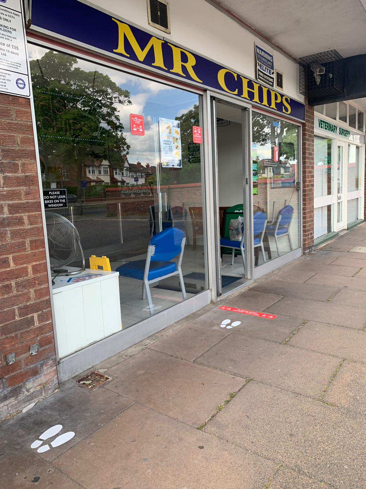New social distancing signs created by Southport firm Magnetic Activation outside Mr Chips chippy in Churchtown in Southport