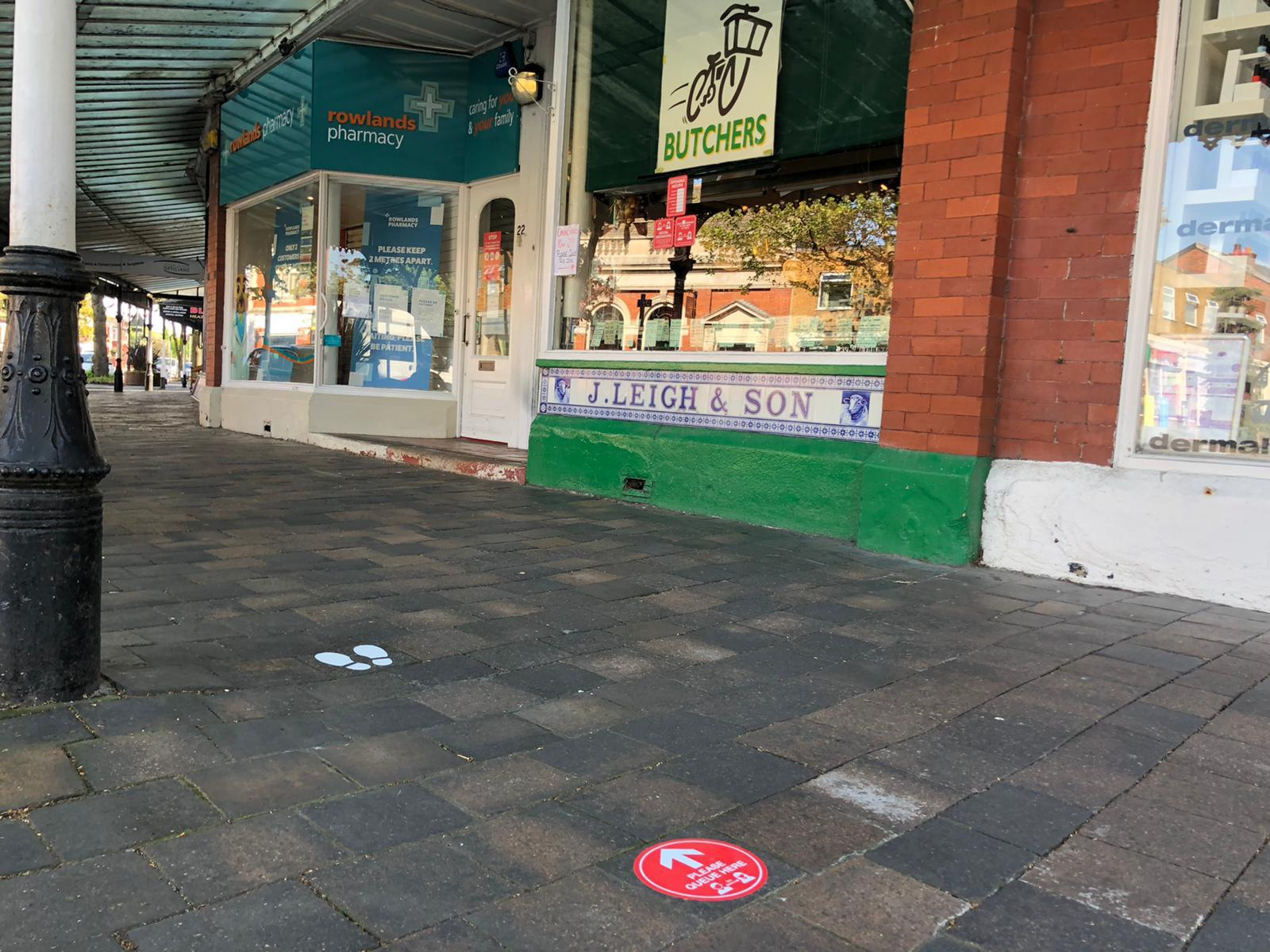 New social distancing signs created by Southport firm Magnetic Activation outside Broughs butchers in Birkdale in Southport