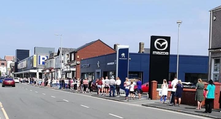 People queue for the reopening of the Sports Direct store in Southport on Monday June 15, 2020