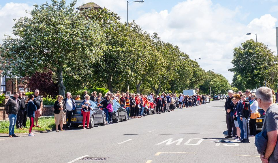 Players and supporters of Southport Rugby Football Club formed a guard of honour along Waterloo Road near the club to pay tribute to Club President Graham Ellis who died aged 64