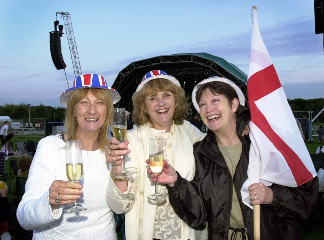 Pat Easterway, Sue Rowe and Pauline Fearns enjoy the Southport Summer Classics at Victoria Park in Southport on July 30, 2004. Photo by Rob Lovett