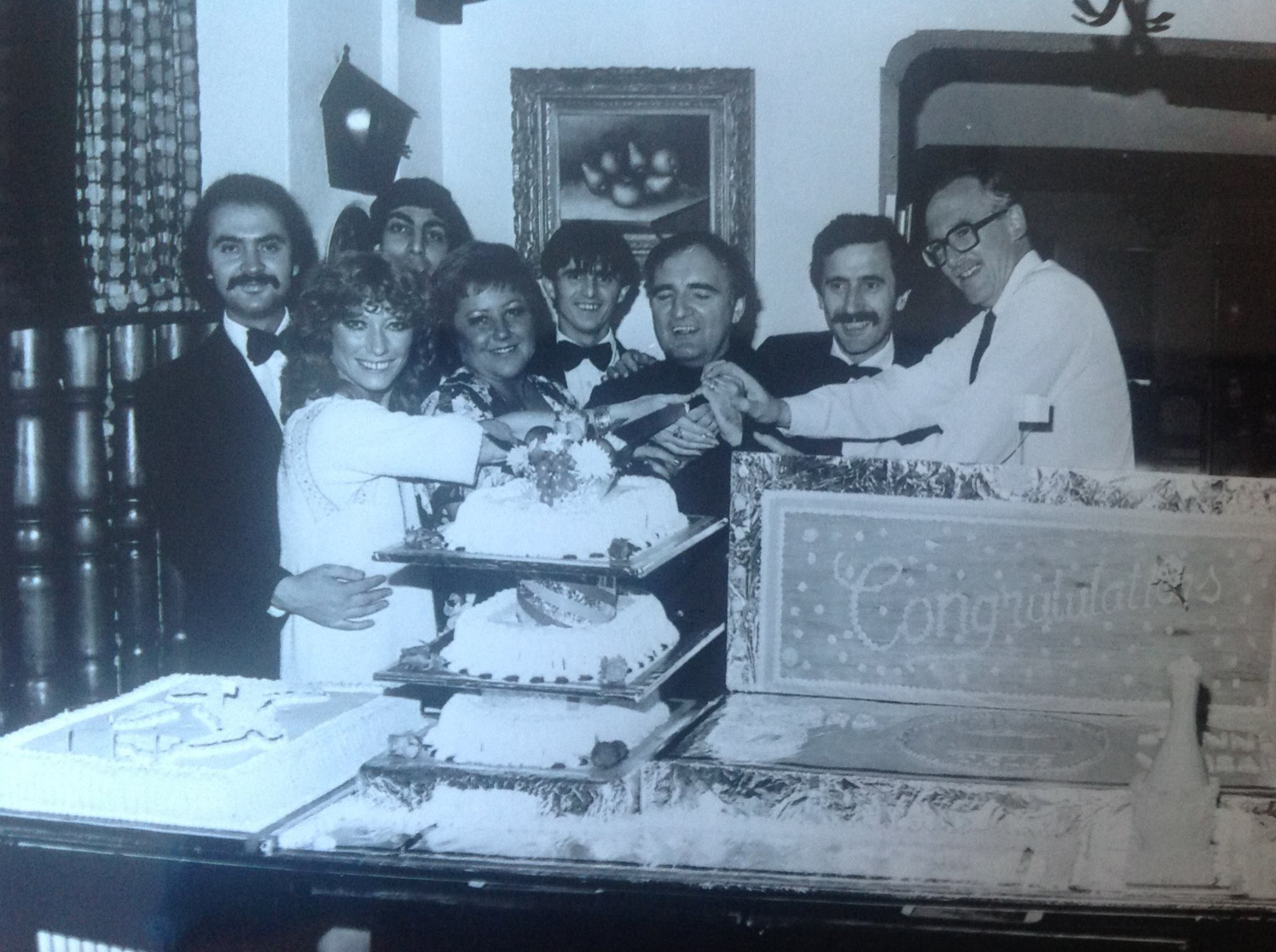 Staff at Casa Italia restaurant on Lord Street in Southport celebrate the venue's third birthday party in September, 1981. The Grossi family, which owned the restaurant for many years, were joined by cartoonist Bill Tidy (right) to cut the cake.