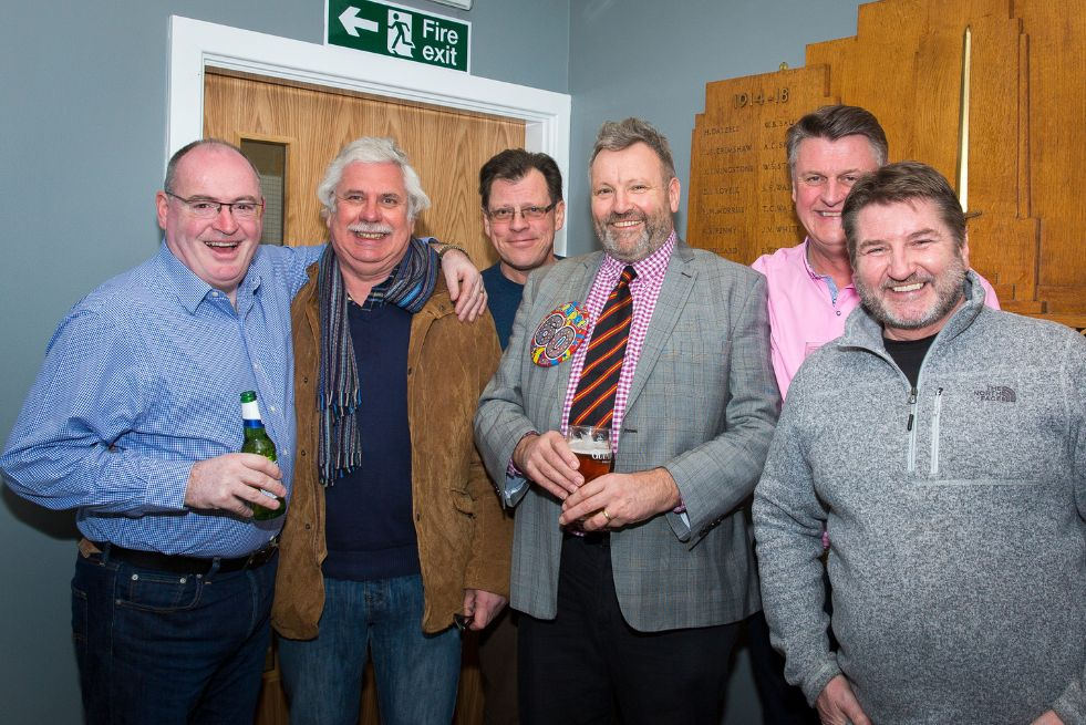 Graham Ellis (fourth left) celebrates his 60th birthday at Southport Rugby Football Club with friends including former club president Steve Olive (second left). Photo by Angus Matheson of Wainwright & Matheson Photography