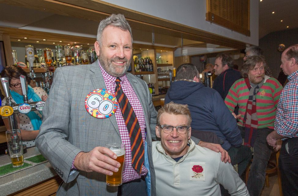 Graham Ellis (left) celebrates his 60th birthday at Southport Rugby Football Club with Ed Fletcher (right). Photo by Angus Matheson of Wainwright & Matheson Photography
