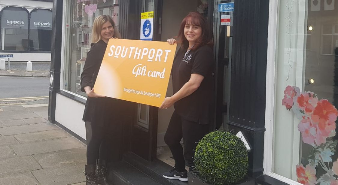 Southport BID CEO Rachel Fitzgerald (left) and Tina Bulmer, owner of Over The Moon Kids Boutique on Union Street in Southport, launch the new Southport Gift Card