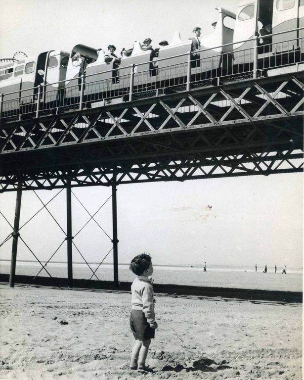 Chris Latham watches on Southport Beach as the Southport Pier train rattles past. Photo by Southport Visiter photographer George Latham Photo courtesy of Chris Latham