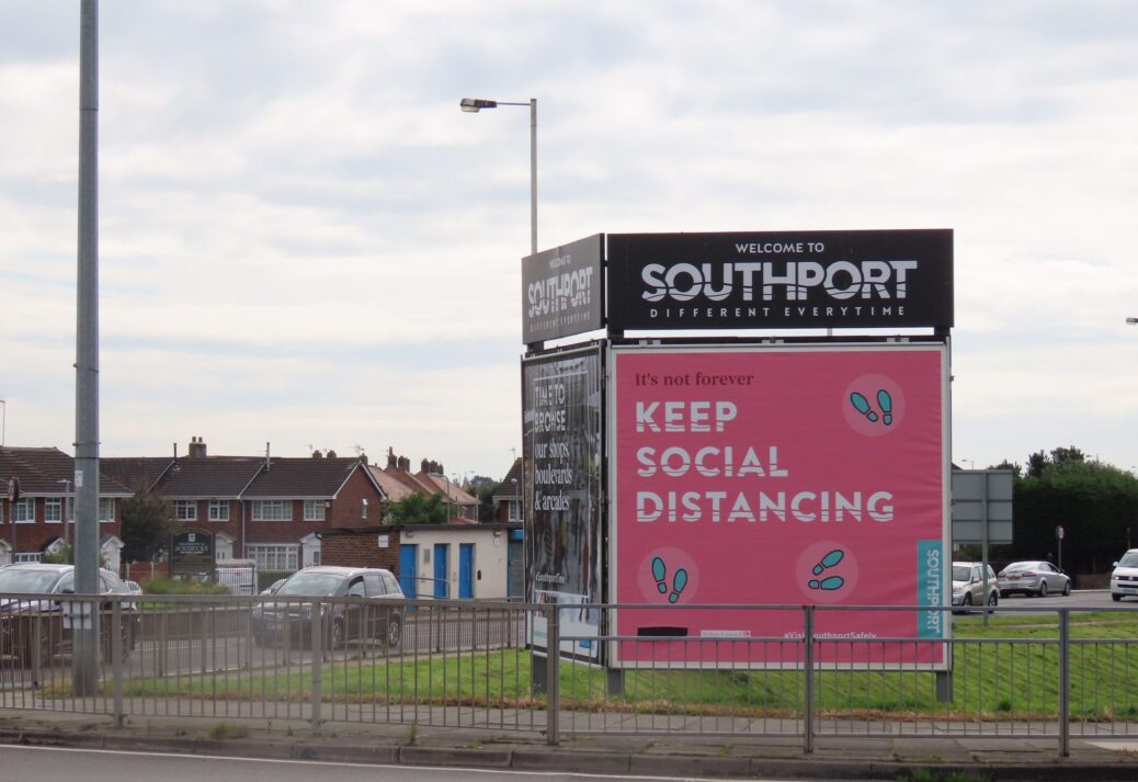 The social distancing coronavirus / Covid-19 sign board on Preston New Road in Crossens in Southport