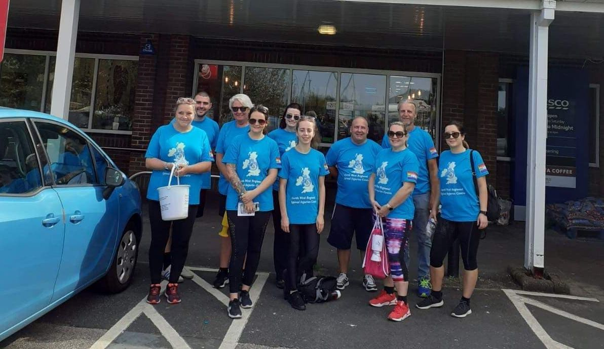 NHS staff from Southport Hospital walked from Southport to Liverpool on Wednesday 17 September, 2020 to raise money for a new minibus for patients at the North West Regional Spinal Injuries Centre in Southport. They are pictured outside Tesco supermarket in Formby