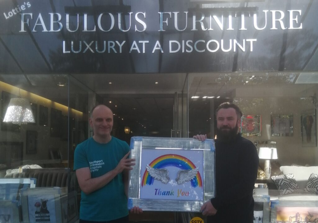 Andrew Byrne, the owner of Fabulous Furniture on Lord Street in Southport, donates a special picture to Ashley Flint from Southport & Ormskirk Hospital NHS Trust