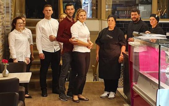 Staff at The Grill Hunters restaurant on Lord Street in Southport, including owner Emily Serban (sixth left) and husband Lulu Serban (fifth left)