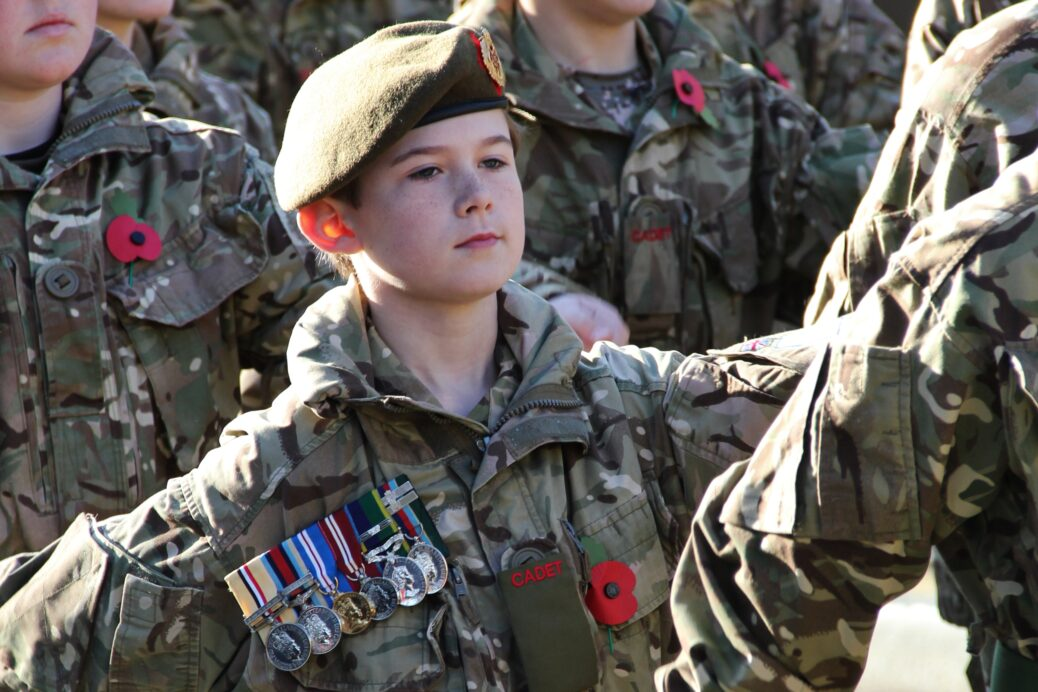 A young cadets wears his father's medals at a Remembrance Parade. Photo by Major Roy Bevan