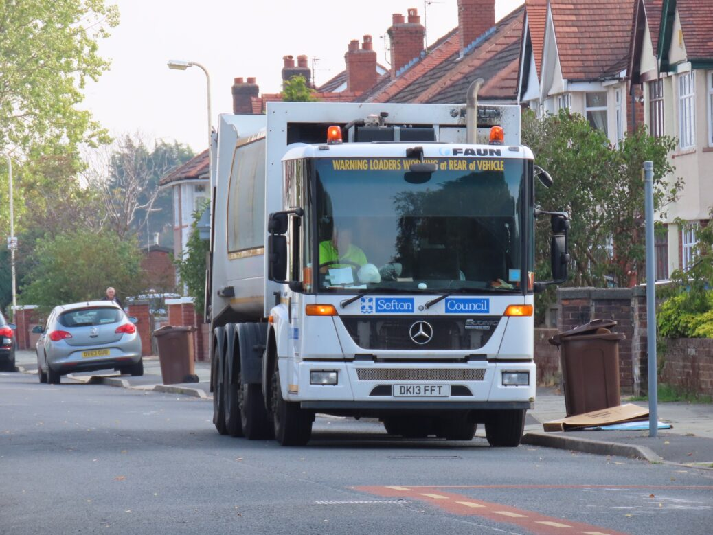 Refuse collectors at work in Southport. Photo by Andrew Brown Media