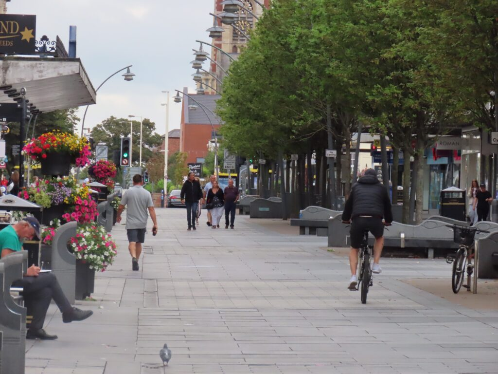 Cycling on Chapel Street in Southport
