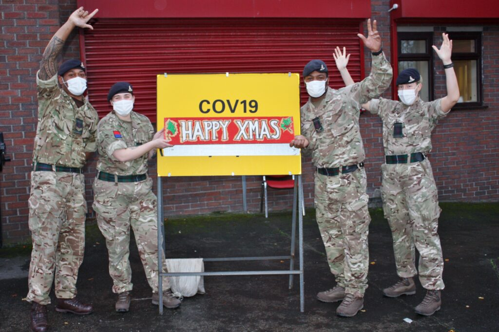 Soldiers at Altcar Training Camp in Hightown wish people in Merseyside a Merry Christmas 2020. Photo by Major Roy Bevan