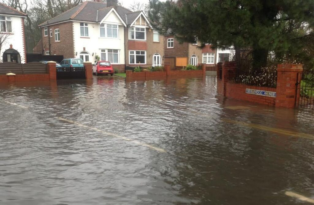 A flooded Merlewood Avenue in Churchtown in Southport. Photo by Andrew Brown Media