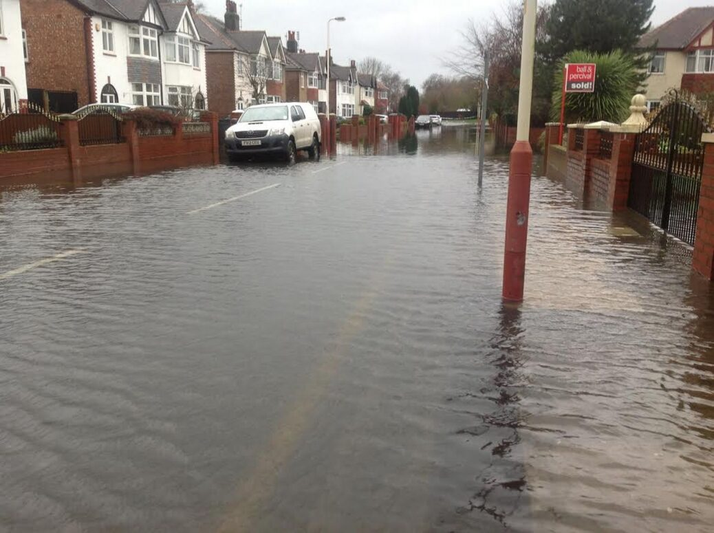 A flooded Verulam Road in Churchtown in Southport. Photo by Andrew Brown Media