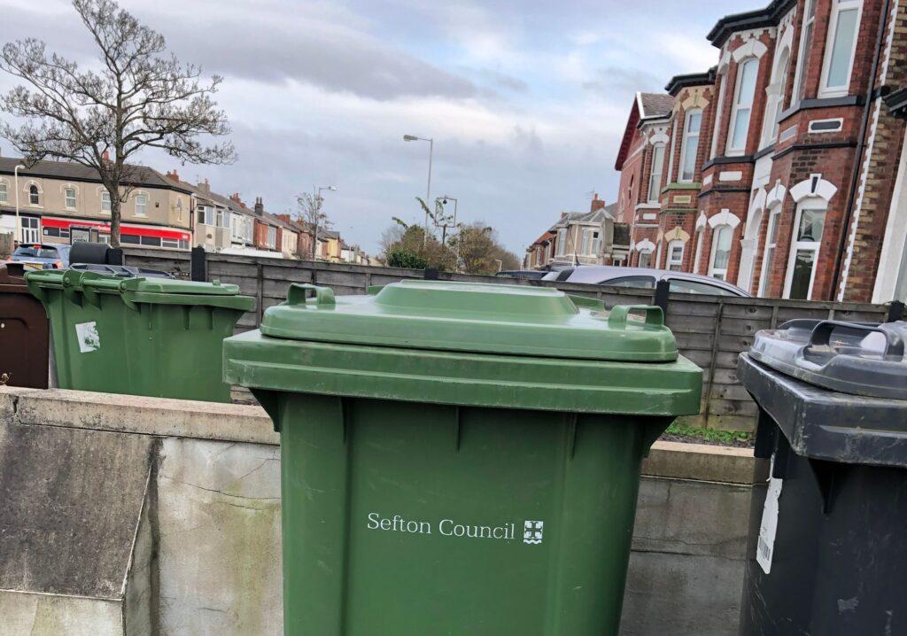 A green wheelie bin for garden waste recycling by Sefton Council