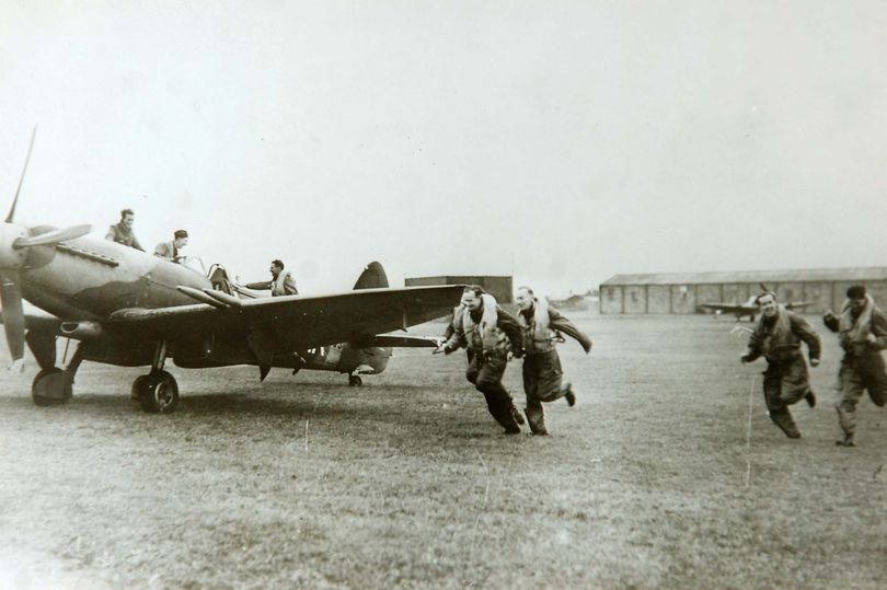 Pilots scramble for their Spitfires at RAF Woodvale