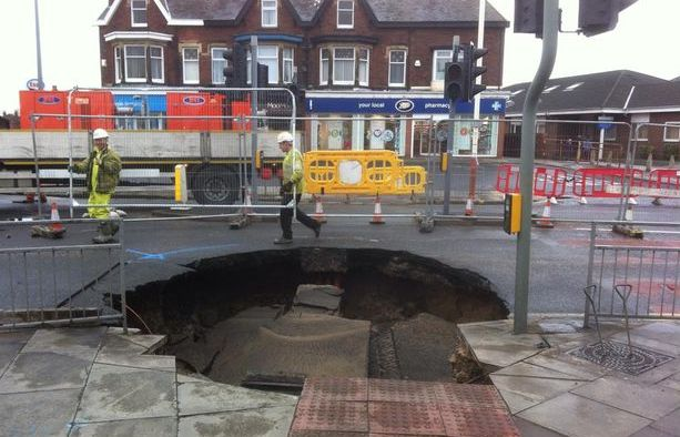 The sinkhole which appeared on the corner of Cambridge Road and Preston New Road in Churchtown in Southport on 13 March 2015. Photo by Lee Stirrup