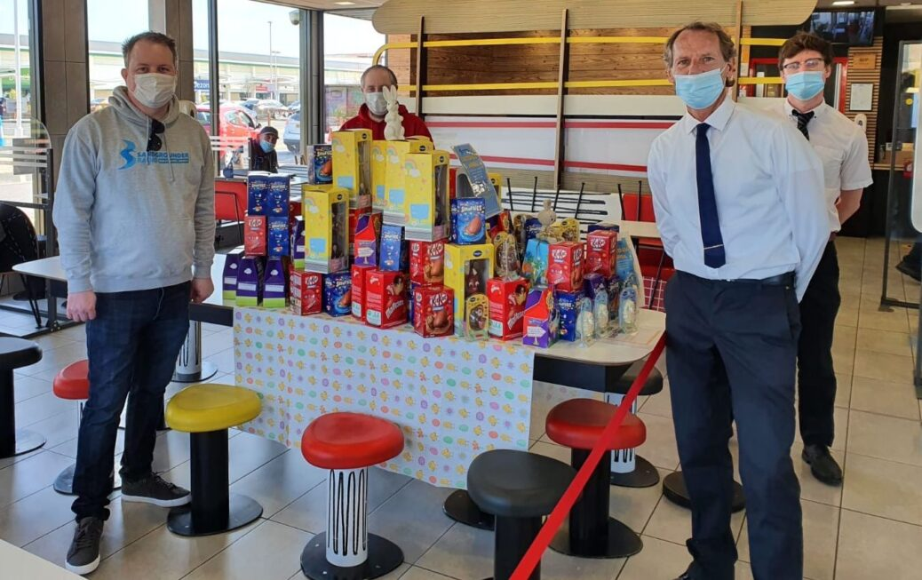 Staff at McDonalds at Ocean Plaza in Southport with the Easter eggs they collected for the Sandgrounder Radio appeal