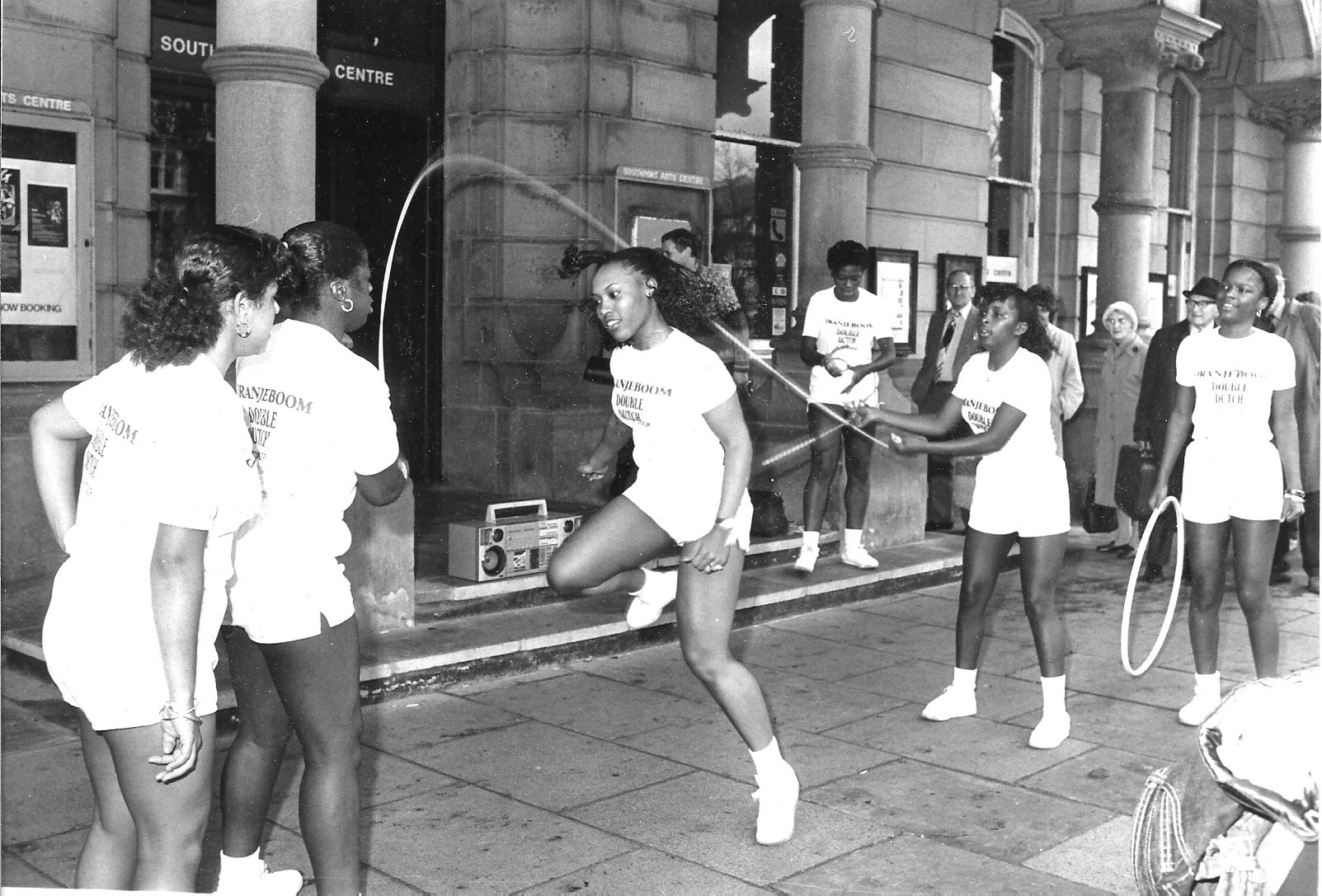 Oranjeboom Double Dutch perform with a skipping rope, a hula hoop and a ghetto blaster outside Southport Arts Centre on Lord Street in Southport in November 1983