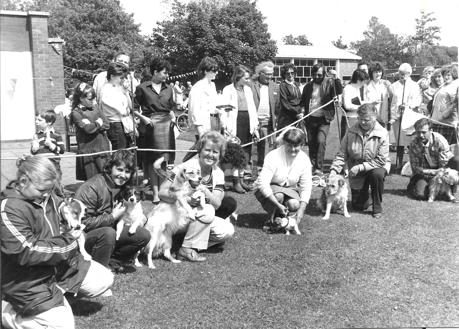 Visitors and their pets enjoy the Greaves Hall Fair in Banks, near Southport, on 3 June 1984