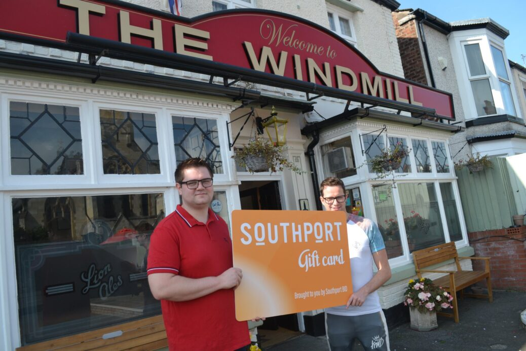 Neil Walsh and partner Tom Hodgin at The Windmill pub on Seabank Road in Southport with the Southport Gift card