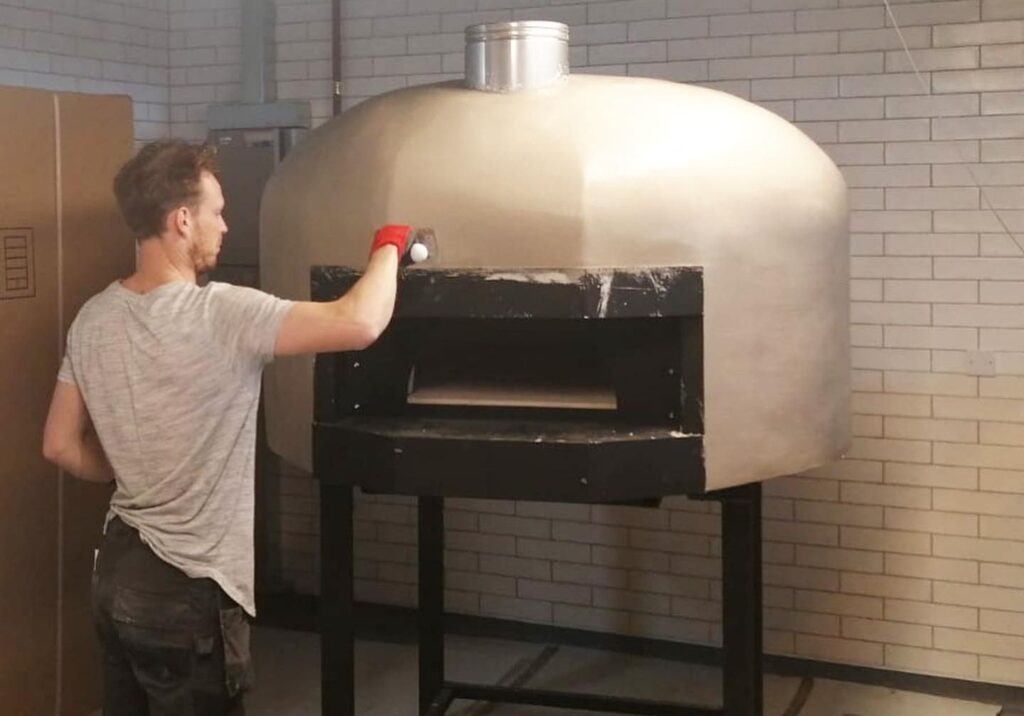 600 Degrees is building a new pizza oven, ready for when they move into their new unit in Southport Market
