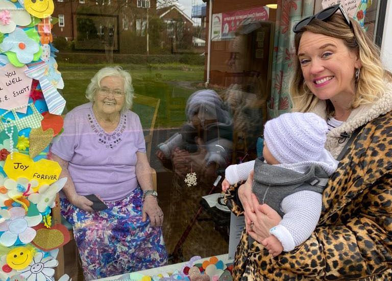 Baby Agnes, and her Mum Lucy, paying a window visit to her great grandmother Agnes Kelly at Connell Court in Southport