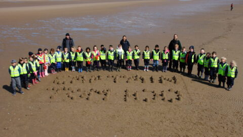 Pupils build 100 sandcastles on Southport Beach for 'Captain Tom 100' challenge