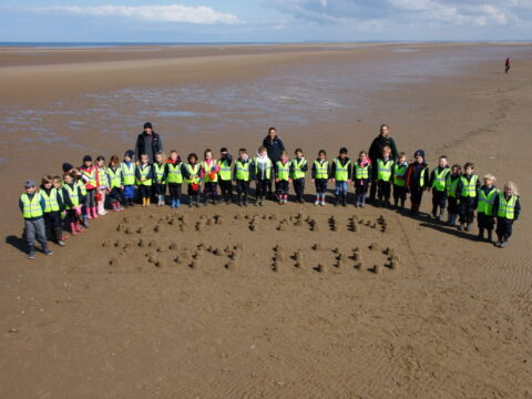 Pupils build 100 sandcastles on Southport Beach for 'Captain Tom 100' challenge