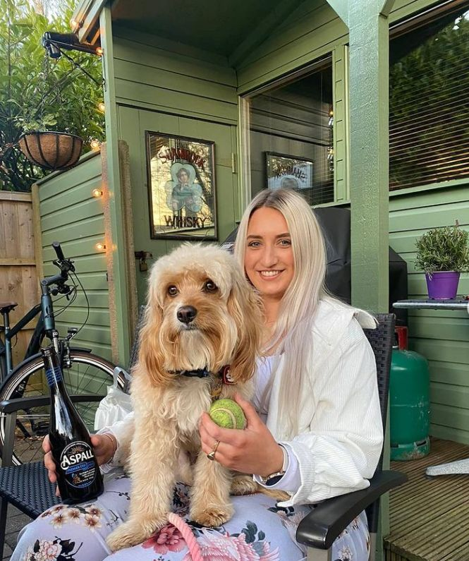 Olivia Gillingham, the owner of The Dog House in Southport, with Reggie