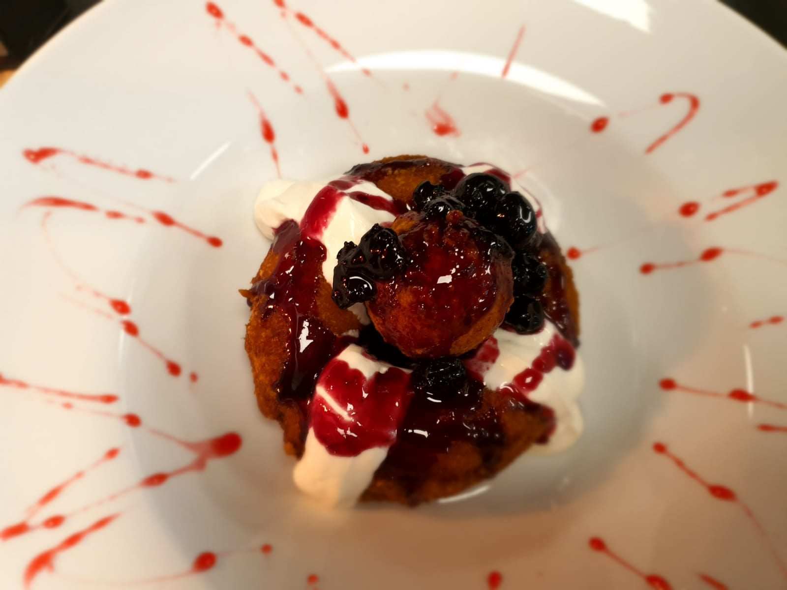 A dessert at Grill Hunters on Lord Street in Southport. Doughnut with sour cream and cherries
