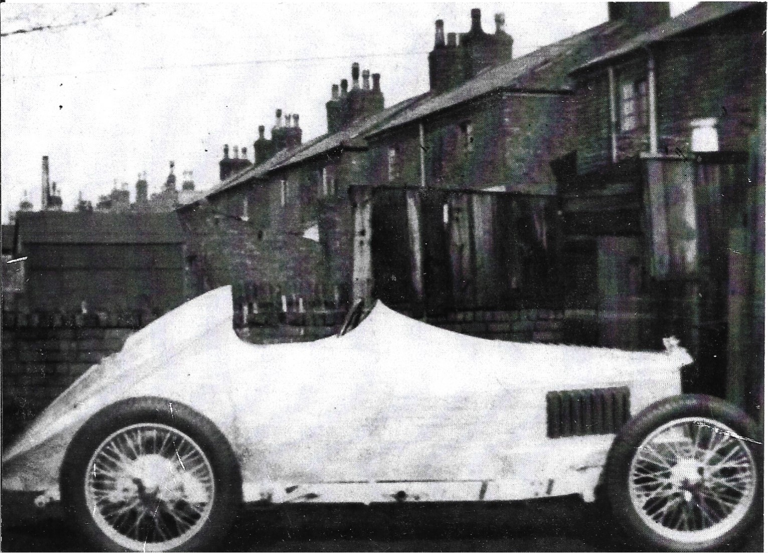 The MG J3 single seater conversion outside the workshop behind houses somewhere in Southport where it was looked after. Photo by Nev Church
