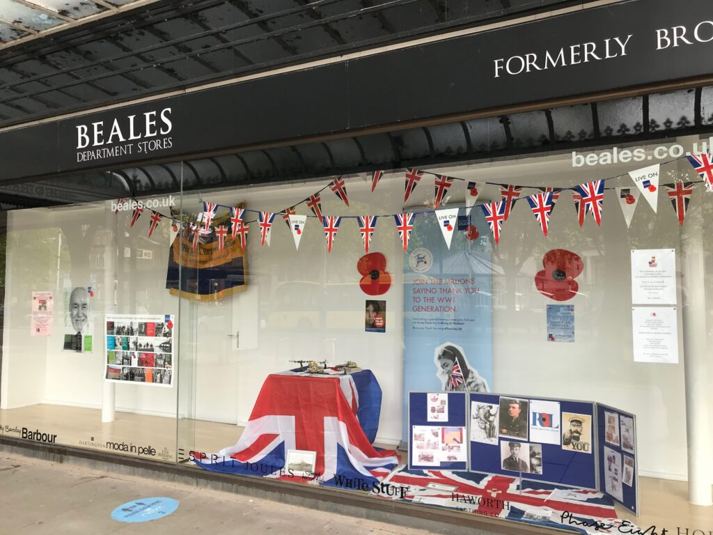 The Royal British Legion window display in the former Beales department store shop window on Lord Street in Southport
