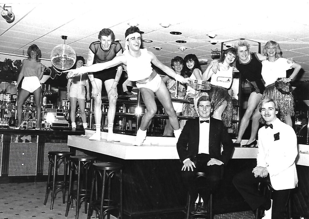 Lots of fancy dress on display at this bar in Southport in May 1984