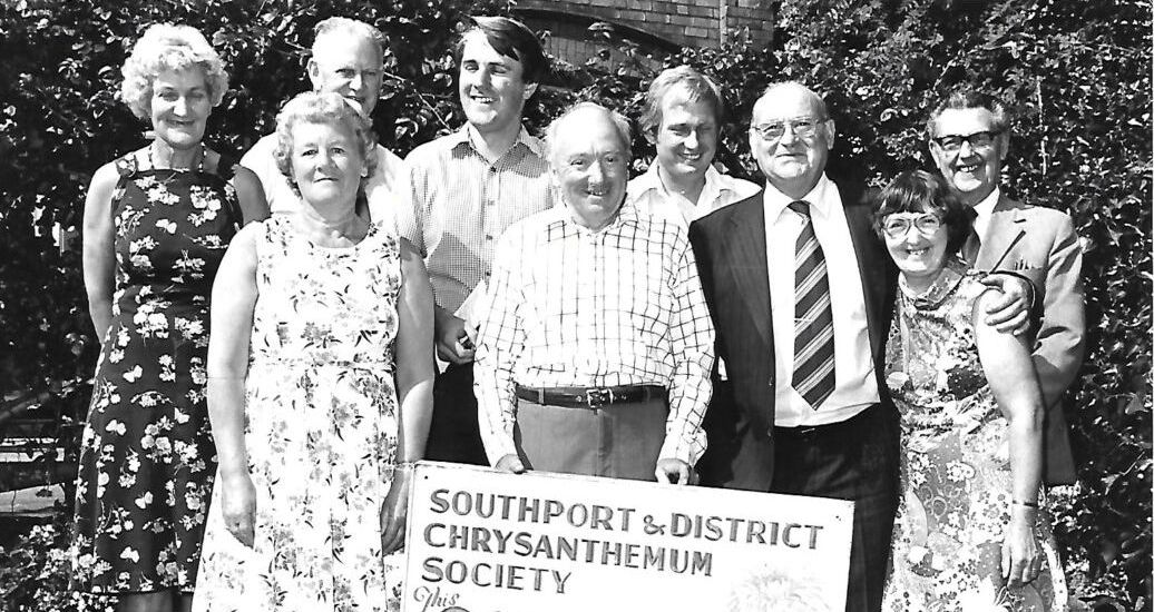 Committee members of Southport Chrysanthemum Society present their show in Southport in September 1981. Alan Foxell is back row, third from left