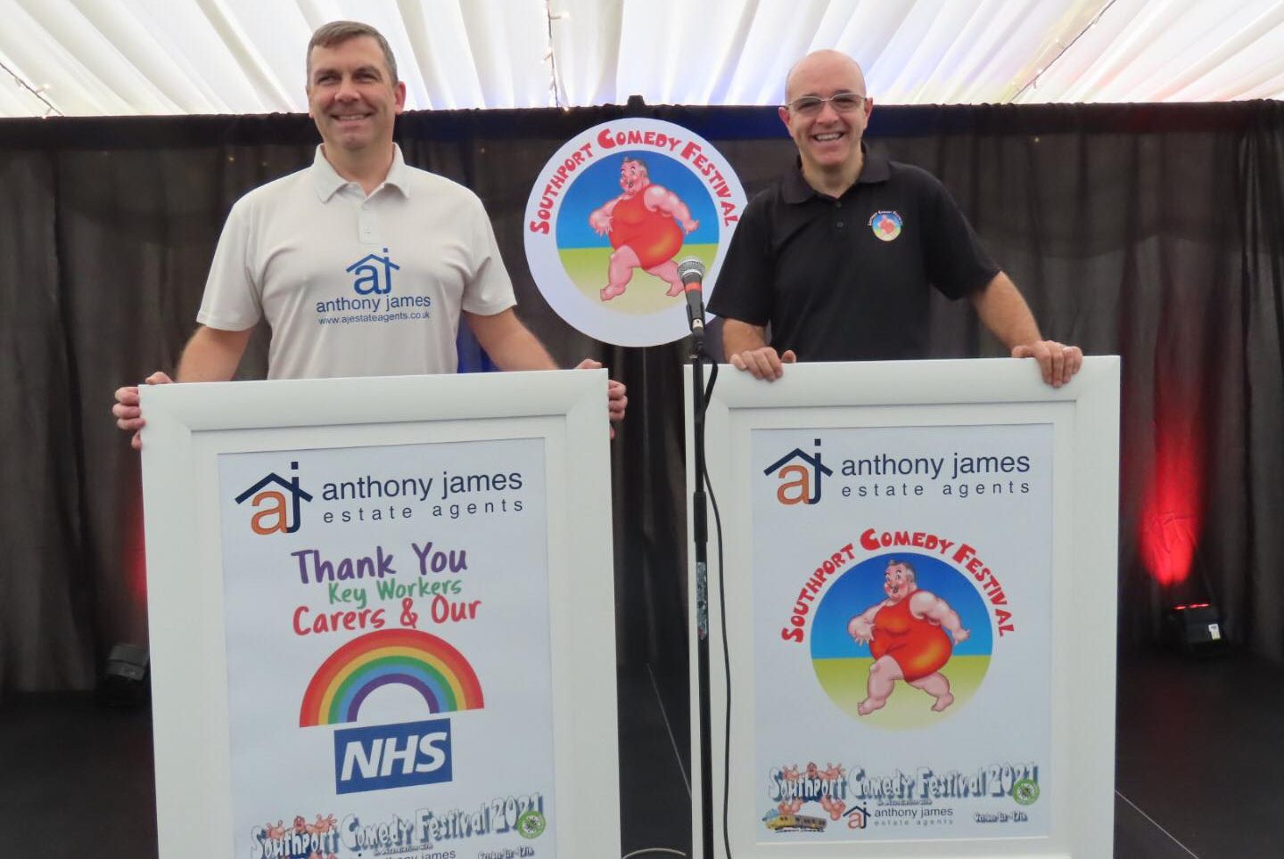 Anthony James Estate Agents is hosting a free Thumbs Up For The NHS Comedy Bingo night at Southport Comedy Festival to thank NHS and care staff for the incredible job they have done during the Covid pandemic. Pictured are Anthony Estate Agents Director Mark Cunningham (left) and Festival Director Brendan Riley (right). Photo by Andrew Brown Media