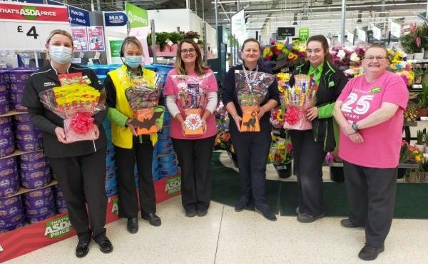 Southport ASDA supermarket community champion Sharon Gregory-Wareing (right) has raised around £1,000 by making sweet boxes and cones and selling them to colleagues and customers for the Tickled Pink breast cancer appeal